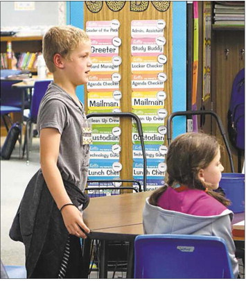 Fourth-grader Carter Wilfong follows Great Expectations practices by standing to answer a question from teacher Susan Coltharp during Monday's class at Sangre Ridge Elementary in Stillwater.